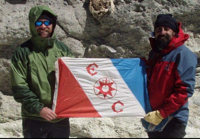 Branndon holding Explorers flag.